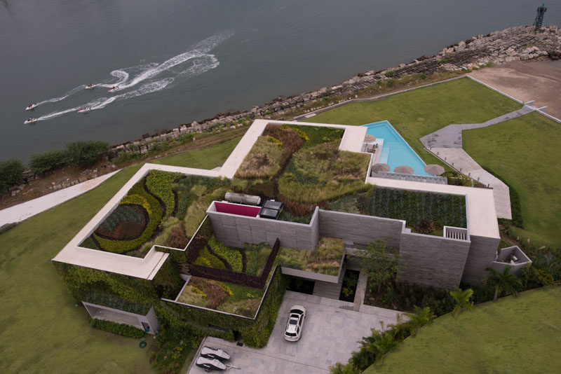 Architecture firm Ezequiel Farca + Cristina Grappin designed a waterfront home in Puerto Vallarta, Mexico, that features a large green roof and expansive outdoor entertaining spaces. #ModernHouse #GreenRoof #HouseDesign #WaterfrontHouse