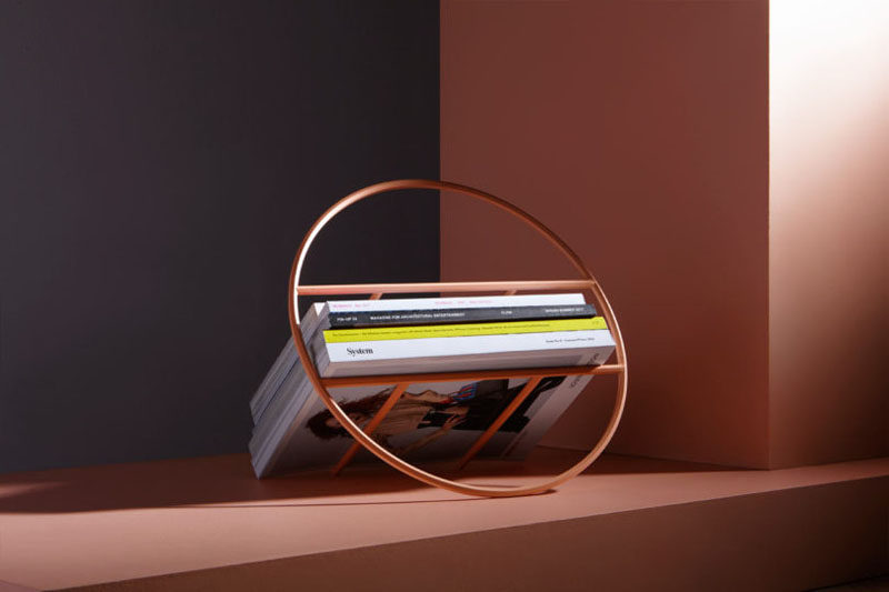 Umbra Studio have designed 'Hoop', a minimalist magazine rack that can also hold up to 24 records. #Storage #HomeDecor #MagazineRack