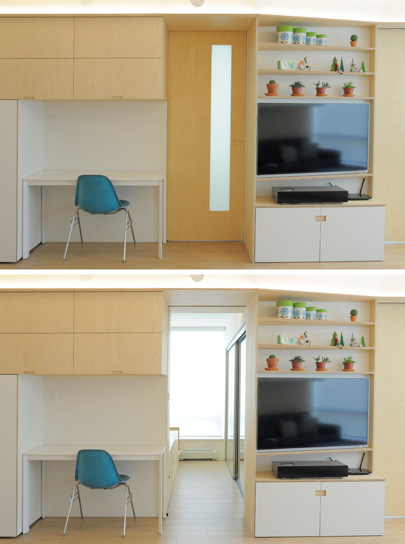 This small study area has a desk that can double as a dining table. Beside the desk is a pocket door that can slide open to reveal the bedroom. #PocketDoor #ApartmentDesign