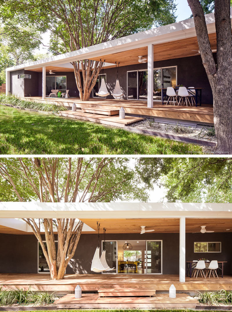 At the rear of this modern home, a back porch was added that runs the entire length of the house. The porch canopy has a cut-out to allow the existing crepe myrtle tree to stay in its original location. #Porch #ModernPorch #OutdoorSpace