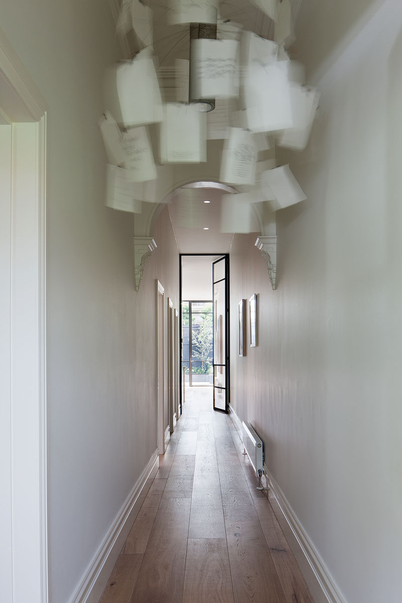 This renovated house has a long hallway that leads right down to the living areas of the home. #Hallway #InteriorDesign