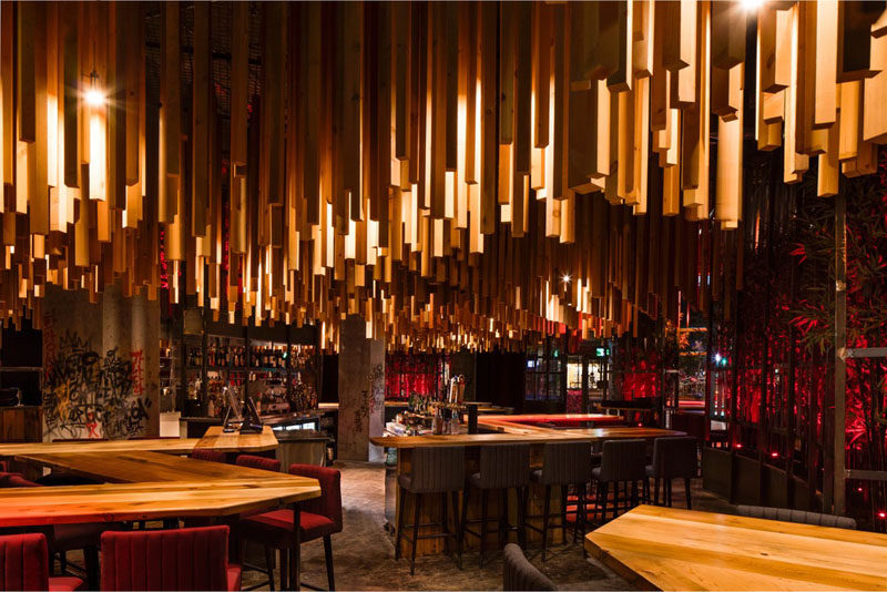 2,700 Wood Lengths Hang From The Ceiling In This New Montreal Restaurant