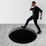 This Rug Is Designed To Create An Optical Illusion That Looks Like There's A Hole In The Floor