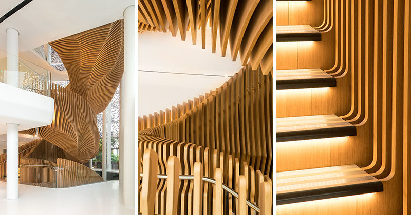 A Snake-like Sculptural Staircase Connects Four Floors Of This Office Building In Paris