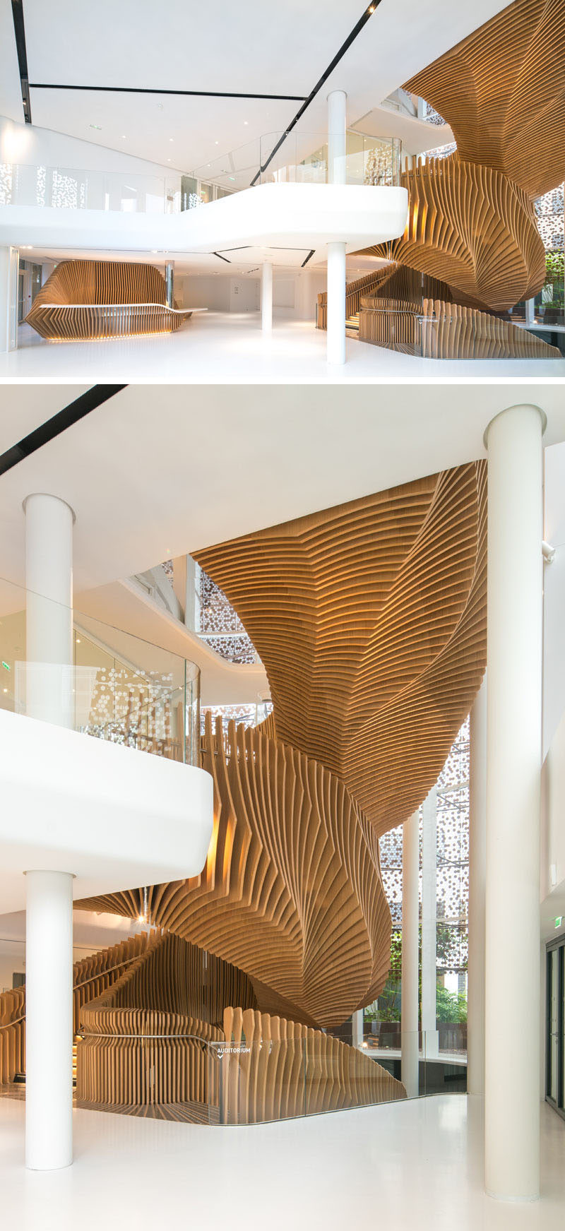 This large, sculptural, snake-like, wood staircase was installed in a new office building in France to connect the four floors of the building. #WoodStairs #SculpturalStairs #StairDesign #OfficeDesign #Stairs