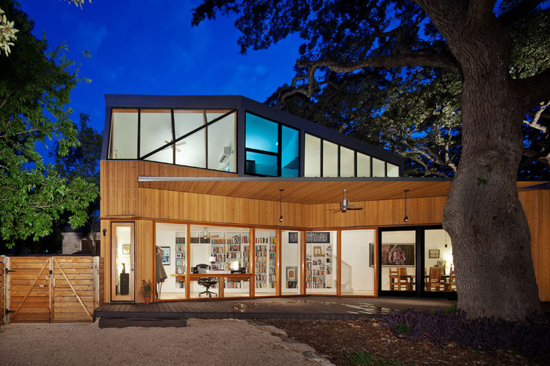 Murray Legge Architecture have designed a modern addition to a 1920s bungalow in Central Austin, Texas, that wraps around an existing 150-year-old oak tree. #Architecture #Addition #Extension #ModernHouse