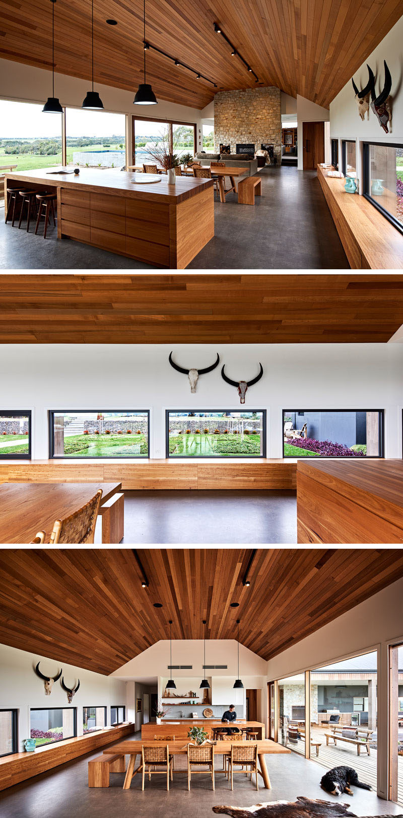 Inside this modern ranch-inspired house, the main living area is open with a Cedar lined cathedral ceiling and due to the position of the house, large picture windows provide 180 degrees of views of the surrounding land. #InteriorDesign #CathedralCeiling #Windows