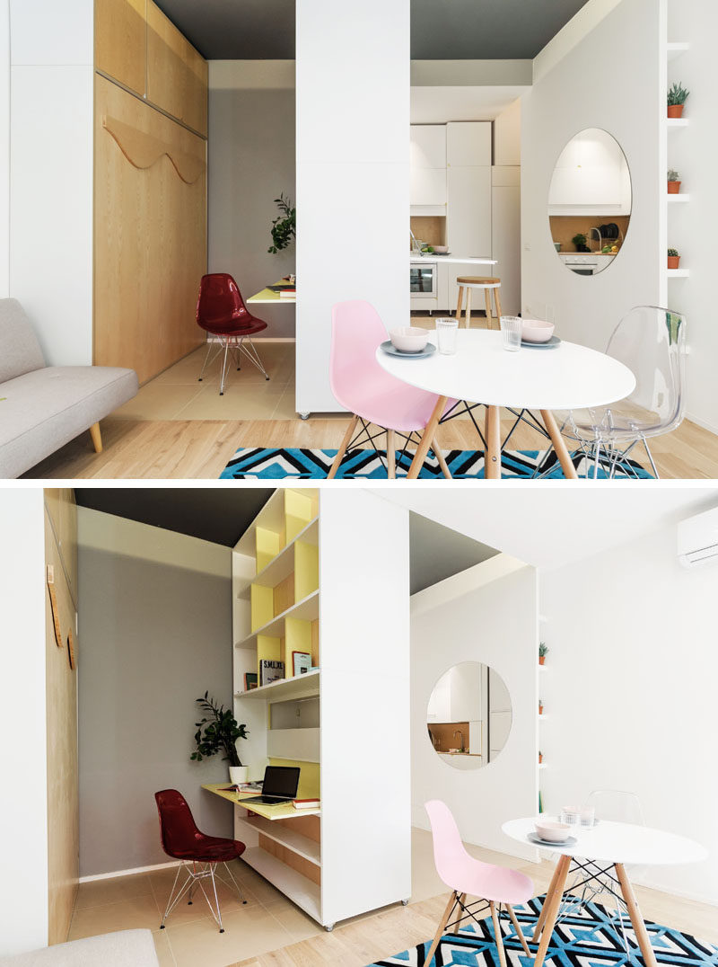 Next to the living room in this micro apartment is a movable wall. When it is positioned in the center, it can have a down desk on one side, and a fold down table on the other. On the desk side, there's open shelving for extra storage. #MicroApartment #MovableWall #InteriorDesign #SmallApartment