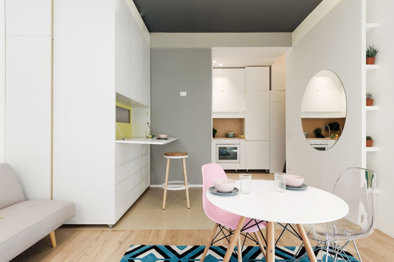 Architecture firm PLANAIR, have designed a small 317 square foot (29.5 sqm) micro apartment in Milan, Italy, that features a movable wall with a variety of functions. #SmallApartment #ApartmentDesign #InteriorDesign