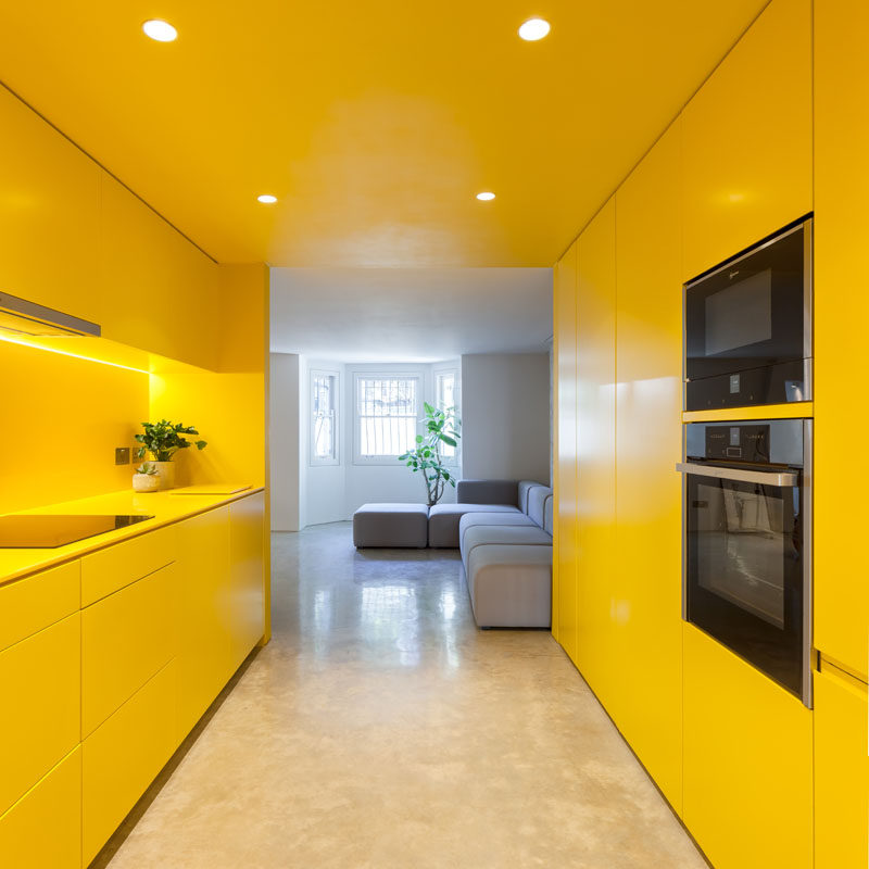 London-based architectural and design practice Russian for Fish, were tasked with brightening up the basement of a Victorian terrace home, and they did this using the color yellow. #ModernKitchen #YellowKitchen #KitchenDesign
