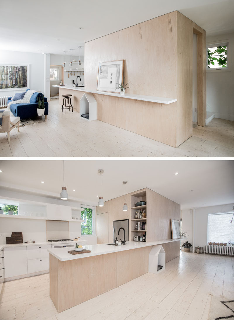 When Studio AC were designing the renovation of a house in Toronto, they made sure to include a design element for the family dog, that consists of a little white dog house built-into the surrounding plywood design element. #DogHouse #BuiltInDogHouse #DogBed #InteriorDesign