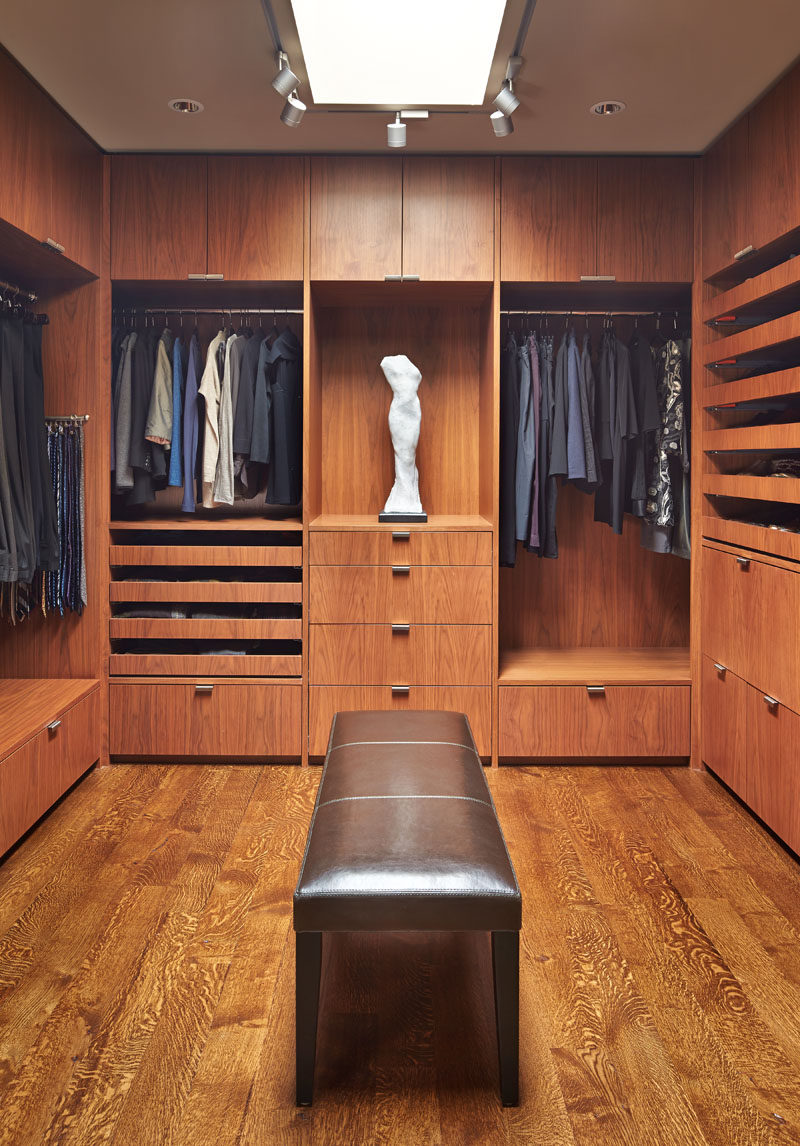 This modern walk-in dressing room has been fitted out with cabinets, shelving, racks and drawers. #WalkInCloset #DressingRoom