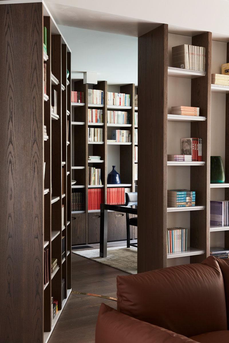 The hidden door in this bookshelf leads to a private study with even more bookshelves. #HiddenDoor #BookShelves #Study