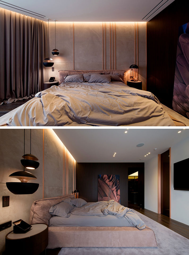 Copper elements have been used in this modern bedroom, with copper pipes featured on the wall behind the bed. Hidden lighting creates a dramatic yet relaxed atmosphere. #ModernBedroom #Copper