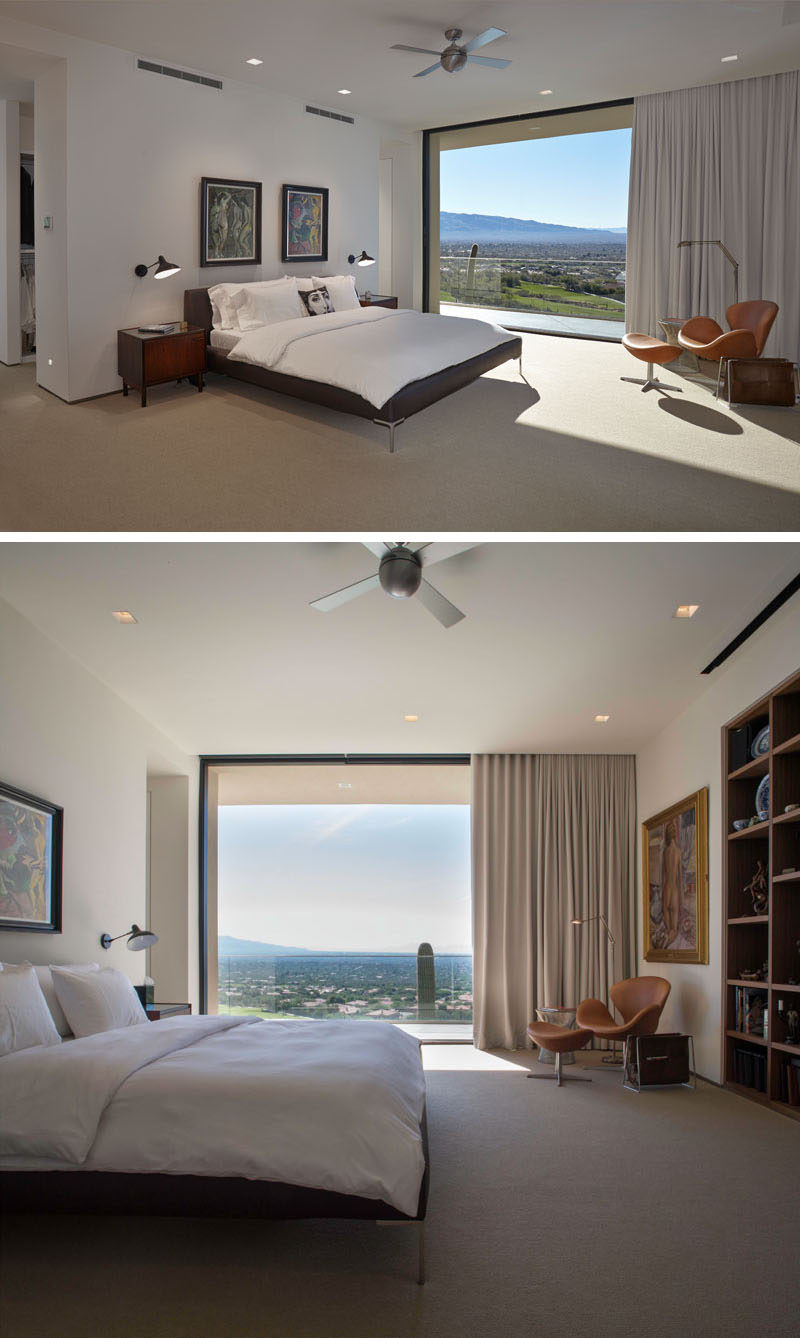 In this modern bedroom, a large floor-to-ceiling sliding glass wall can open to give the bedroom access to a private balcony. #GlassWall #ModernBedroom