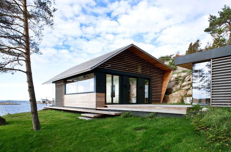 This modern cabin has a wood terrace that connects to a small building that houses a separate bedroom. #Cabin #Architecture