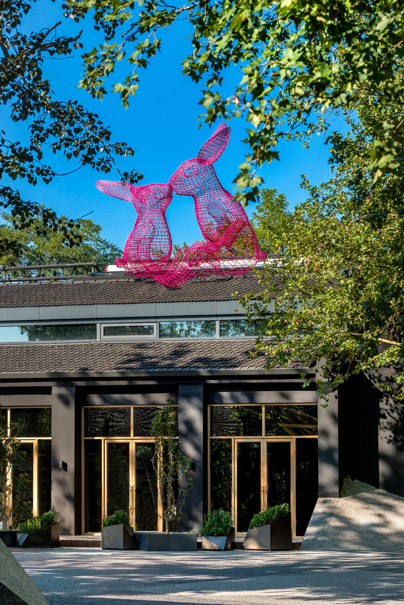 Artwork is scattered throughout this modern hotel in Beijing, like these two whimsical wire-frame rabbits that sit on the roof of The Pink Rabbit Restaurant. #Sculptures #HotelDesign #Beijing