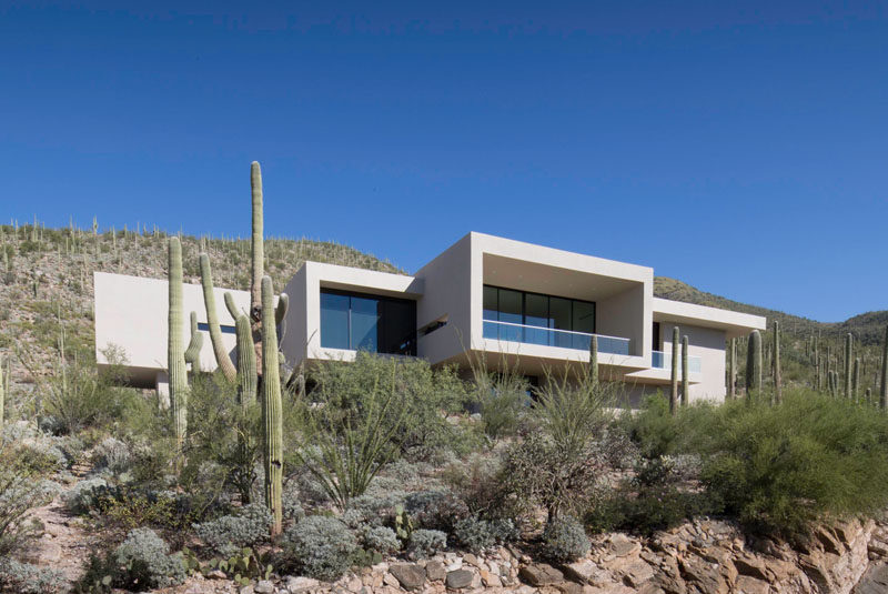 "Kevin B. Howard Architects have designed a modern house in the foothills of Tucson, Arizona, for their client who requested a ""modern, minimal home: a pristine box that seemed to have landed in the desert."" #ModernHouse #Architecture"