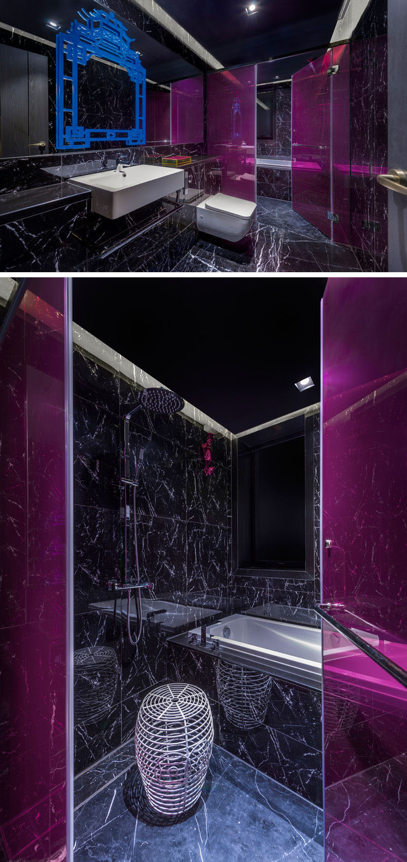 This bold and modern hotel bathroom has pops of color to brighten up the black stone with scattered white veins. #ModernBathroom #BlackBathroom
