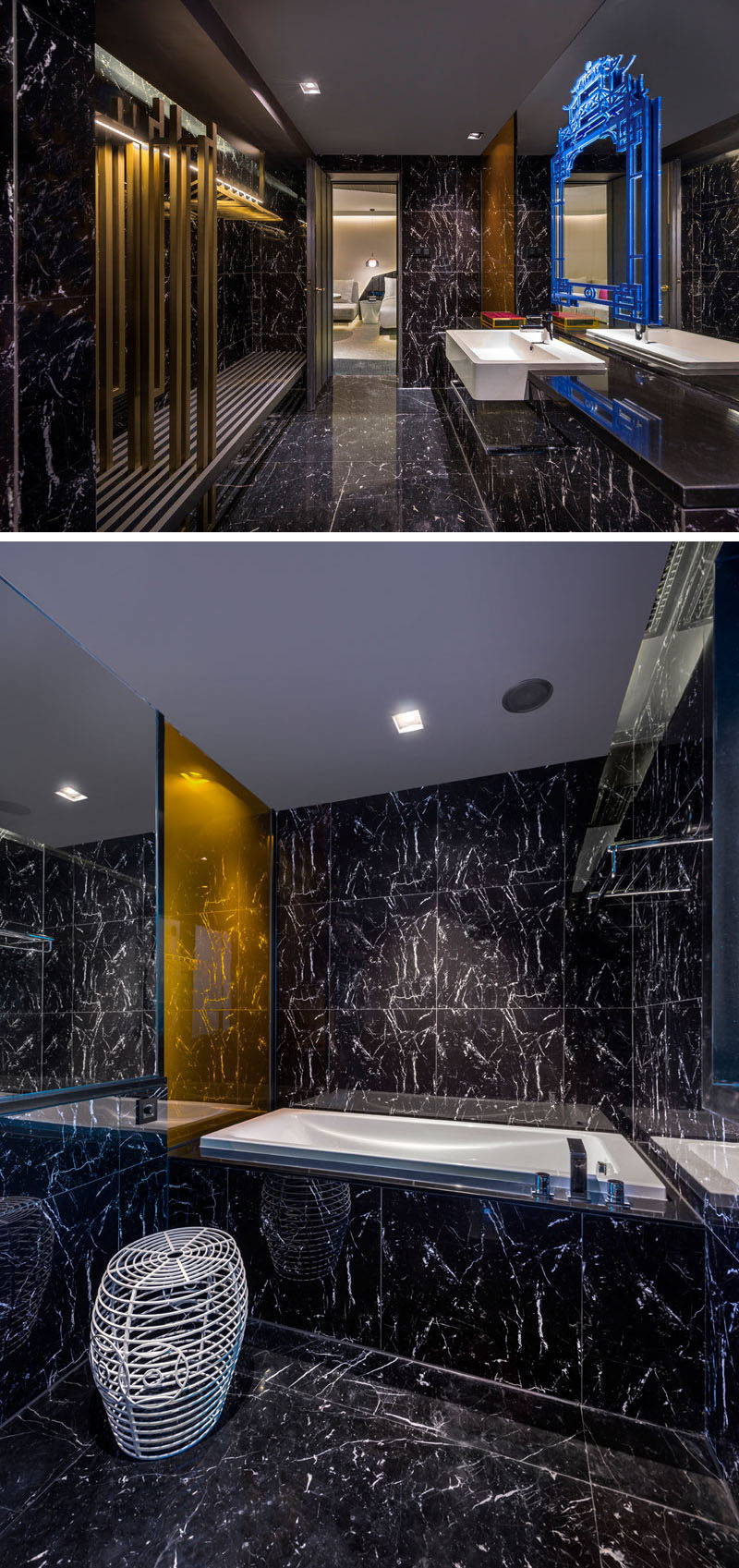 In this modern hotel bathroom, gold accents have been used and a blue artistic decorative accent breaks up the large mirror. #ModernBathroom #HotelBathroom #BlackBathroom