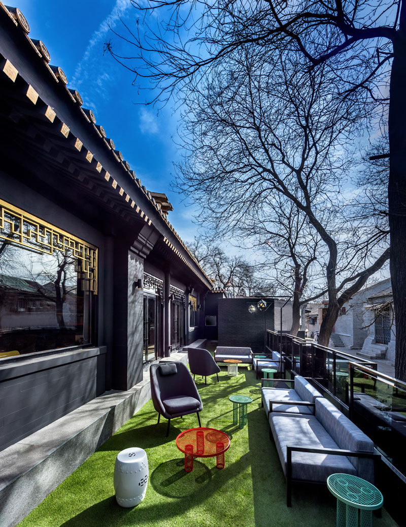 This hotel in Beijing, China, has an outdoor lounge area with couches and chairs, that overlooks the street and neighborhood. #OutdoorLounge #HotelDesign