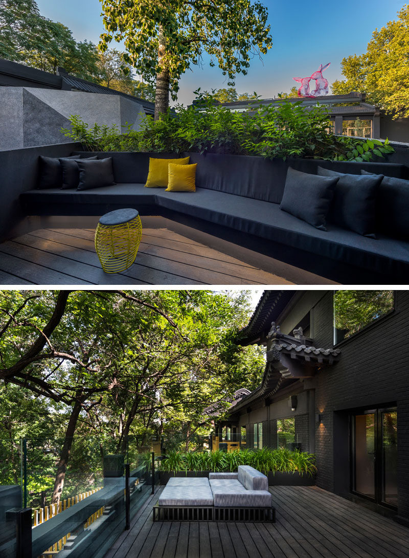 This private balcony has two seating areas, one with a built-in couch, while the other is a standalone daybed. #Balcony #BuiltInCouch #OutdoorSpace
