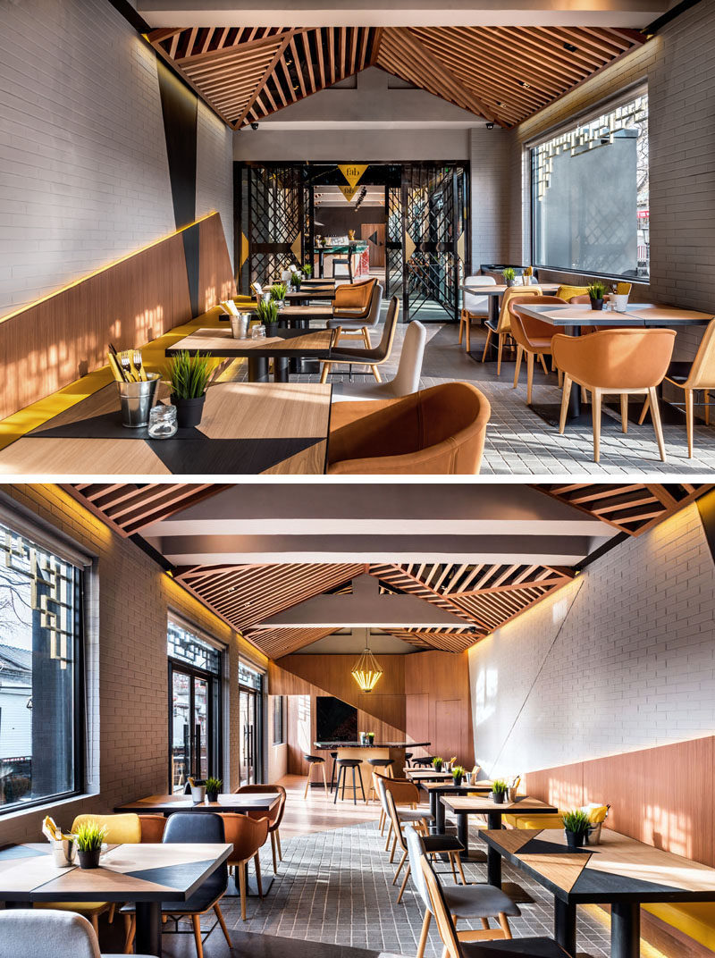 This modern café and bakery has a casual and vibrant atmosphere that's been created using wood and colorful accents. #Cafe #CafeDesign #InteriorDesign