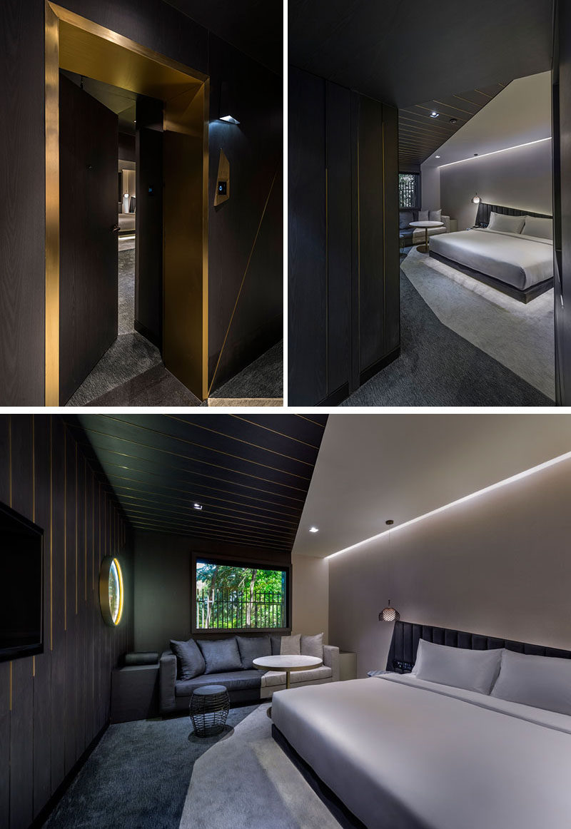 Metallic entryways scattered along dark hallways guide you to the rooms of this modern hotel in Beijing, China. Inside, the angles featured throughout the hotel also show up in the rooms. #HotelRoom #Doorway #HiddenLighting