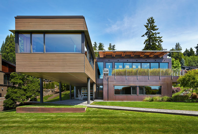 Dark-Stained Cedar Siding And Copper Panels Cover The Exterior Of This Mercer Island House