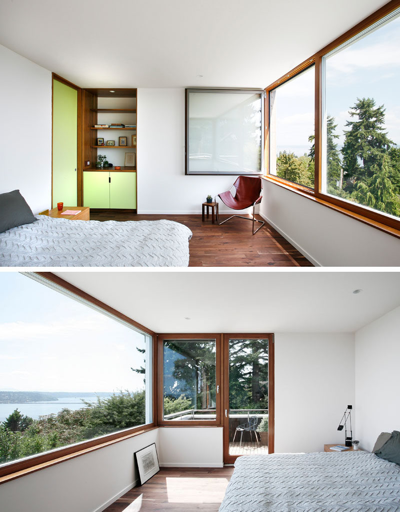 Pastel green has been used to add a touch of color to this modern master bedroom, while picture windows and a small balcony provide views of the surrounding landscape. #MasterBedroom #PictureWindows #Balcony