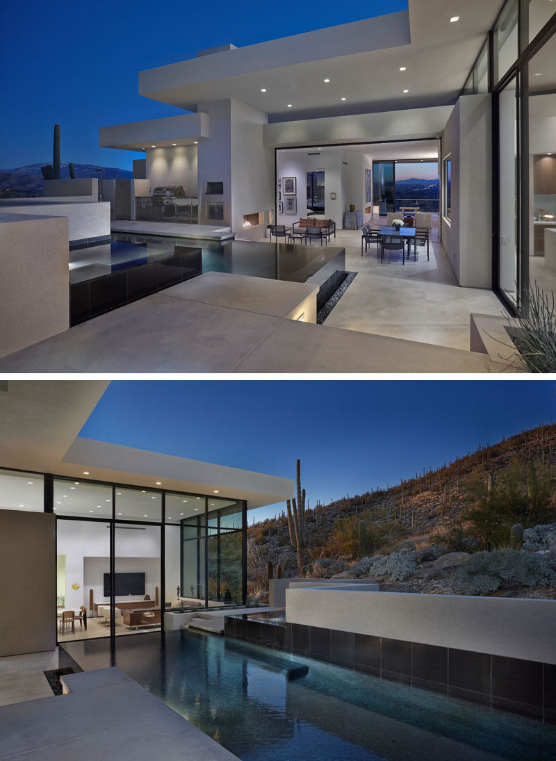 Located off the interior living spaces of this modern house is deck with a swimming pool and spa, an outdoor dining and living area with fireplace, and a bbq / outdoor kitchen. #OutdoorEntertaining #SwimmingPool #ModernHouse