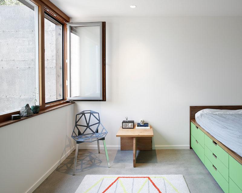 This minimalist bedroom has a bed with built-in storage. #KidsBedroom #BedWithStorage