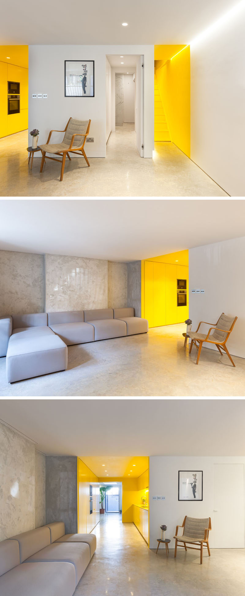 At the bottom of the yellow stairs is a living room that's bright white. A soft grey couch complements the polished, light-toned concrete that's been used for the floor. Off to the side is the entrance to a bold yellow kitchen. #Couch #Yellow #YellowStairs #YellowKitchen