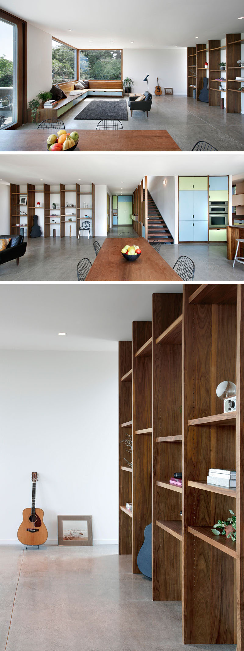 In this modern house, the living room, dining area and kitchen all share the same space, with the living room at one end and the kitchen at the other. Built-in wood benches sit underneath large windows, while a wood shelving unit lines the wall. #InteriorDesign #LivingRoom #Shelving