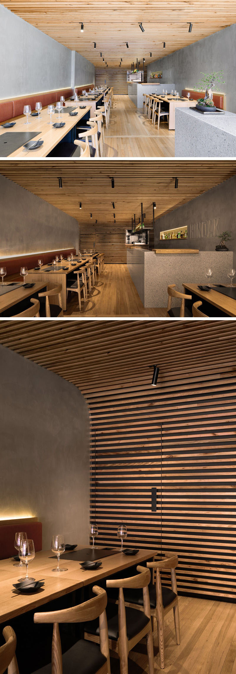 Inside this modern restaurant, the ceiling reflects elements of the finely crafted eaves of traditional Korean houses. The timber-battened ceiling descends gently from the front of the restaurant to the back, and at the end it curves into the rear wall and hides the door. #RestaurantDesign #InteriorDesign #Restaurant
