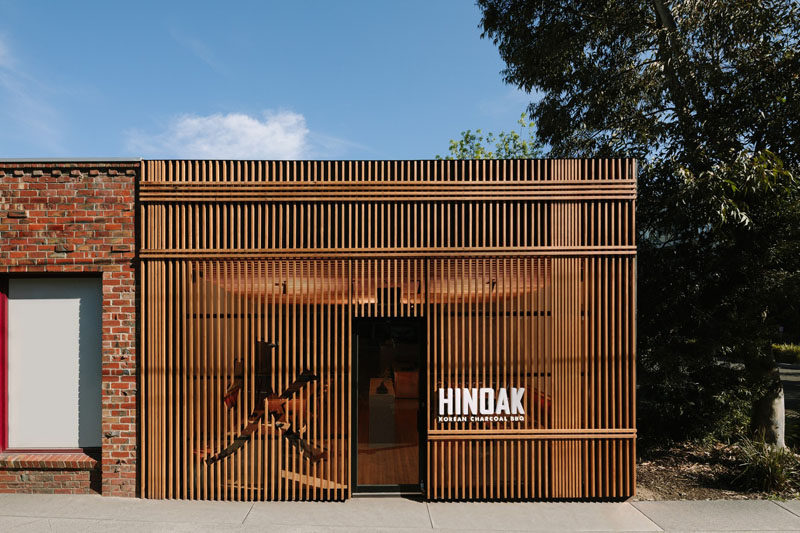 A Vertical Wood Exterior Is The Face Of This New Korean BBQ Custom Exterior Restaurant Design