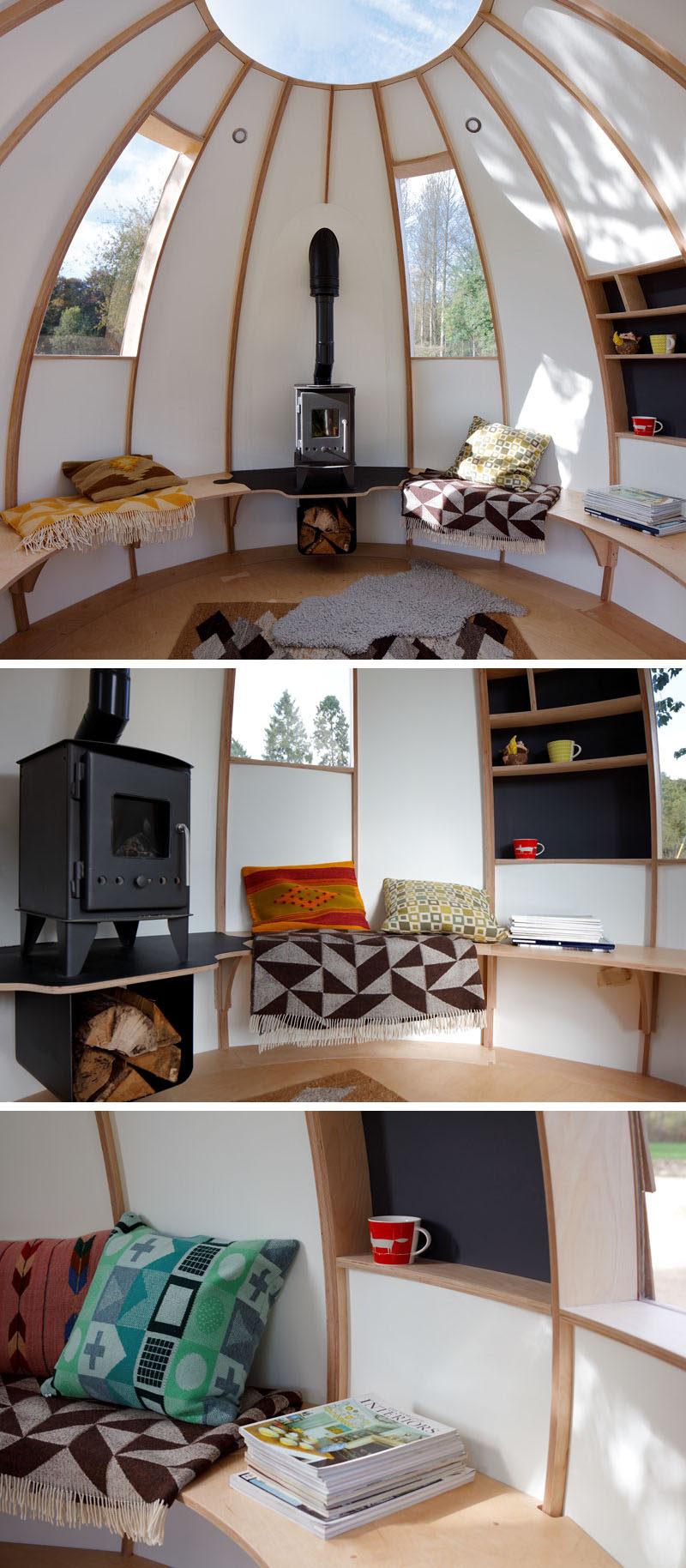 This modern outdoor pod (or garden studio) has a small fireplace to keep warm and windows to enjoy the view. #GardenStudio #BackyardStudio
