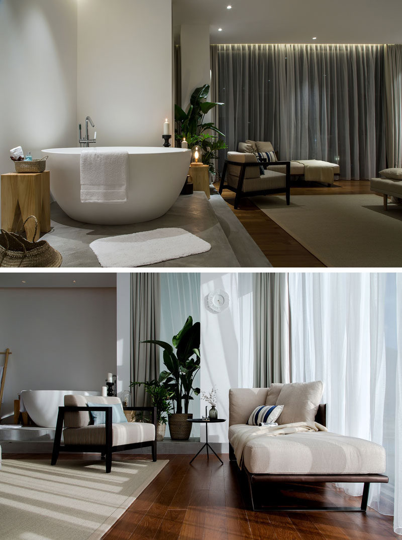 This open plan apartment has a small sitting area bedside the bathtub. #SittingArea #InteriorDesign