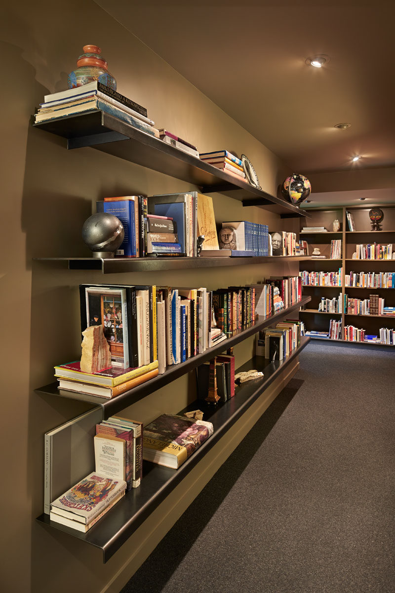 Custom steel shelving provides a place to display this home owners extensive book collection. #SteelShelving #Shelving