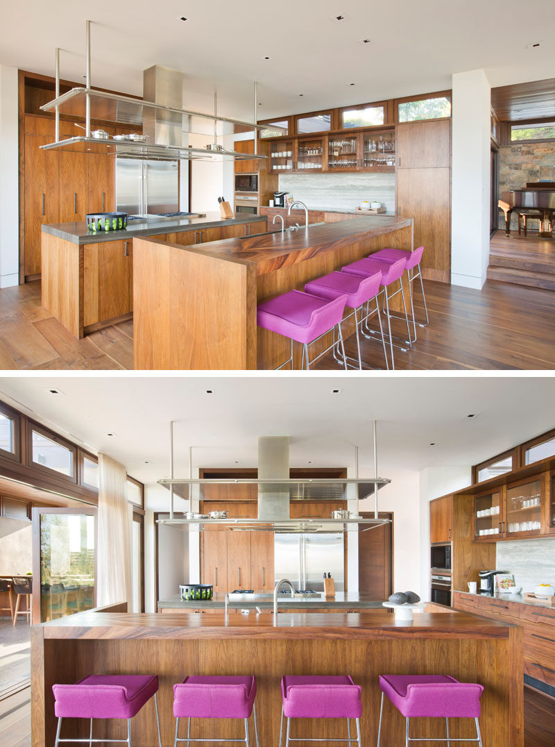 In this modern kitchen, there are two islands and walls of wood cabinets, creating plenty of counterspace and storage. #ModernKitchen #WoodKitchen #KitchenDesign
