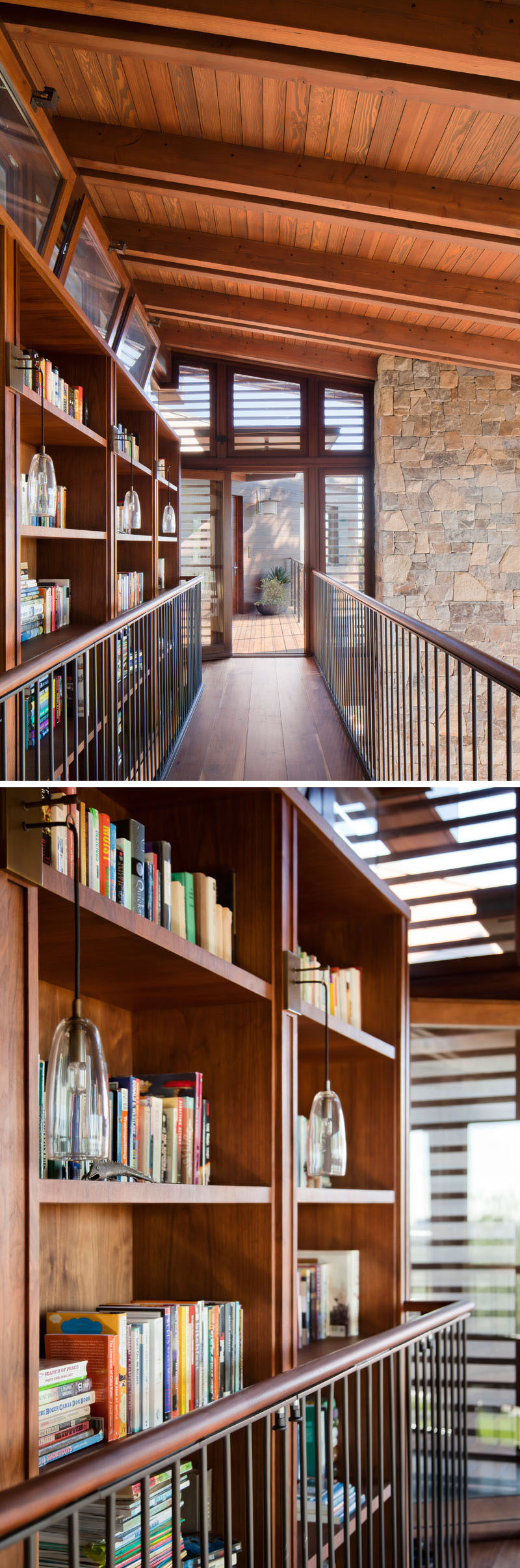 At the top of the stairs in this house is a walkway that connects to the sleeping areas of the home. A large wood bookshelf lines one side of the walkway, while the other looks over the living room and dining area below. #Bookshelf #InteriorWalkway #Shelving