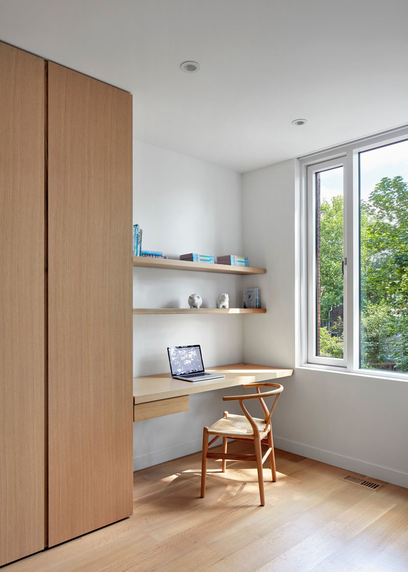 In this modern child's bedroom, a small homework desk is sandwiched between the floor-to-ceiling closet and the wall. Two wood shelves keep favorite items within reach. #Desk #Shelving
