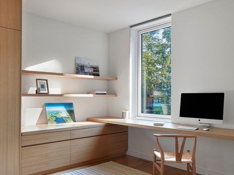 This modern room has built-in wood cabinetry that meets a simple wood desk. Wood shelving provides a place to display personal items. #WoodDesk #ModernDesk #Shelving