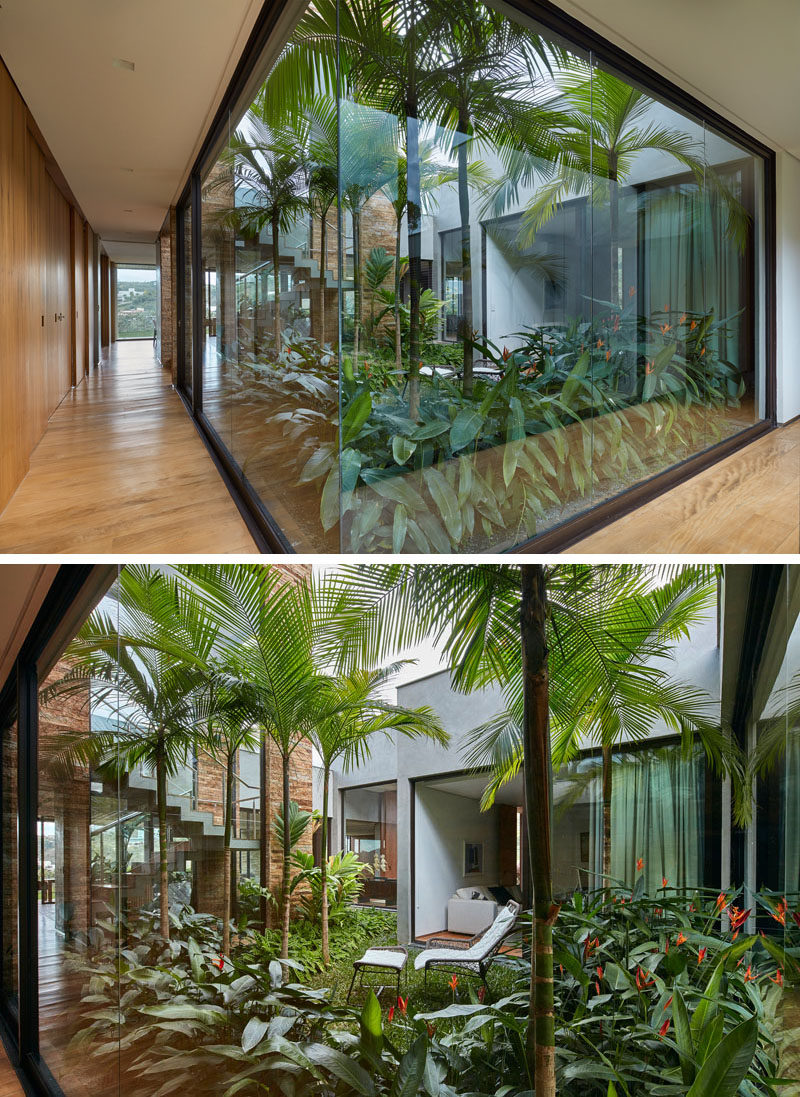 This modern house has an internal garden positioned in the middle of the home, creating a centerpiece that the house wraps around. Floor-to-ceiling windows provide a view of the garden, while at the same time allowing light to flow through to the interior of the home. #InternalGarden #Architecture #Windows