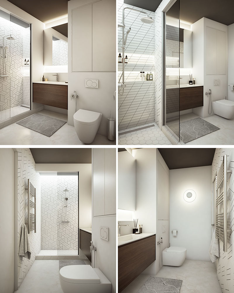In this modern bathroom, there's a wide sink with storage below and a mirror was is lit with with hidden illumination above and below.In the shower, built-in shelves have been installed with more hidden lighting along the wall. #ModernBathroom #HiddenLighting