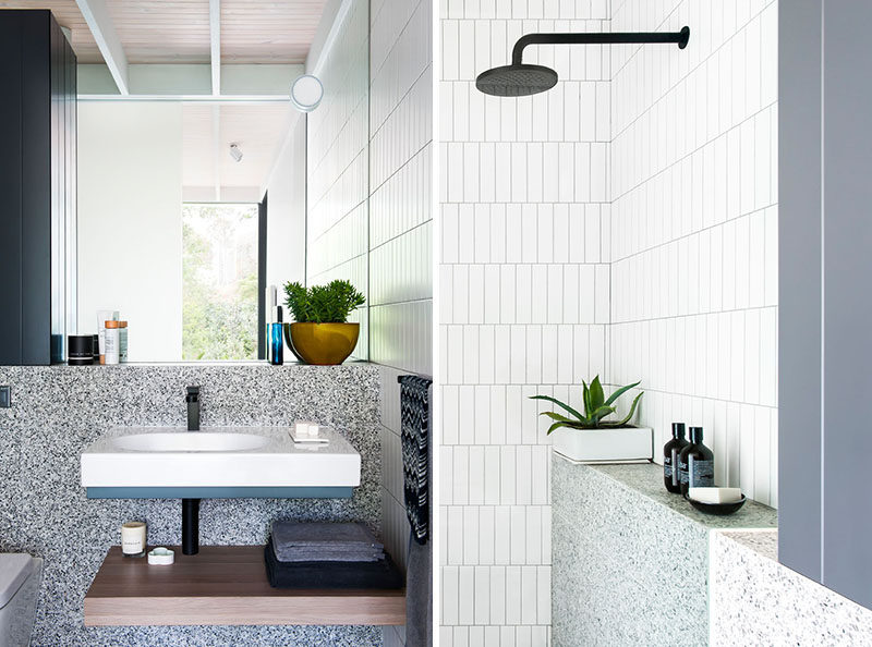 In this small and modern ensuite bathroom there's a vanity with a wood shelf below it and a walk-in shower. #SmallModernBathroom #SmallBathroom #EnsuiteBathroom