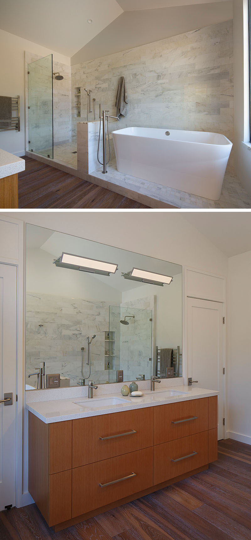 In this modern bathroom, a high ceiling makes the room feel spacious, while a tiled area is home to the walk-in shower and the freestanding white bathtub. On the opposite wall, a wood vanity is topped with a white counter and a large mirror helps to reflect light. #ModernBathroom #BathroomDesign