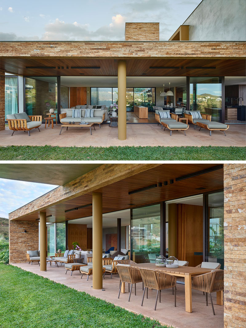 The living areas of this modern house all open up to a covered outdoor entertaining area with various seating options and an alfresco dining area. #OutdoorEntertaining #OutdoorDining