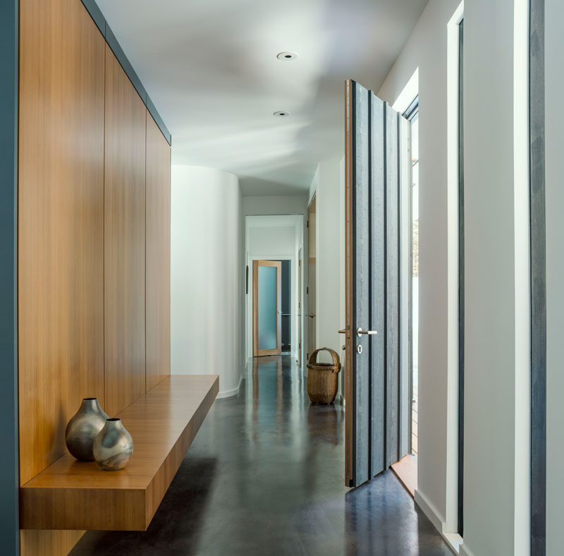 The interior of this modern house has a minimalist palette of finished concrete floors, painted walls and western red cedar details. #Minimalist #ModernHouseInterior #ConcreteFloors #InteriorDesign