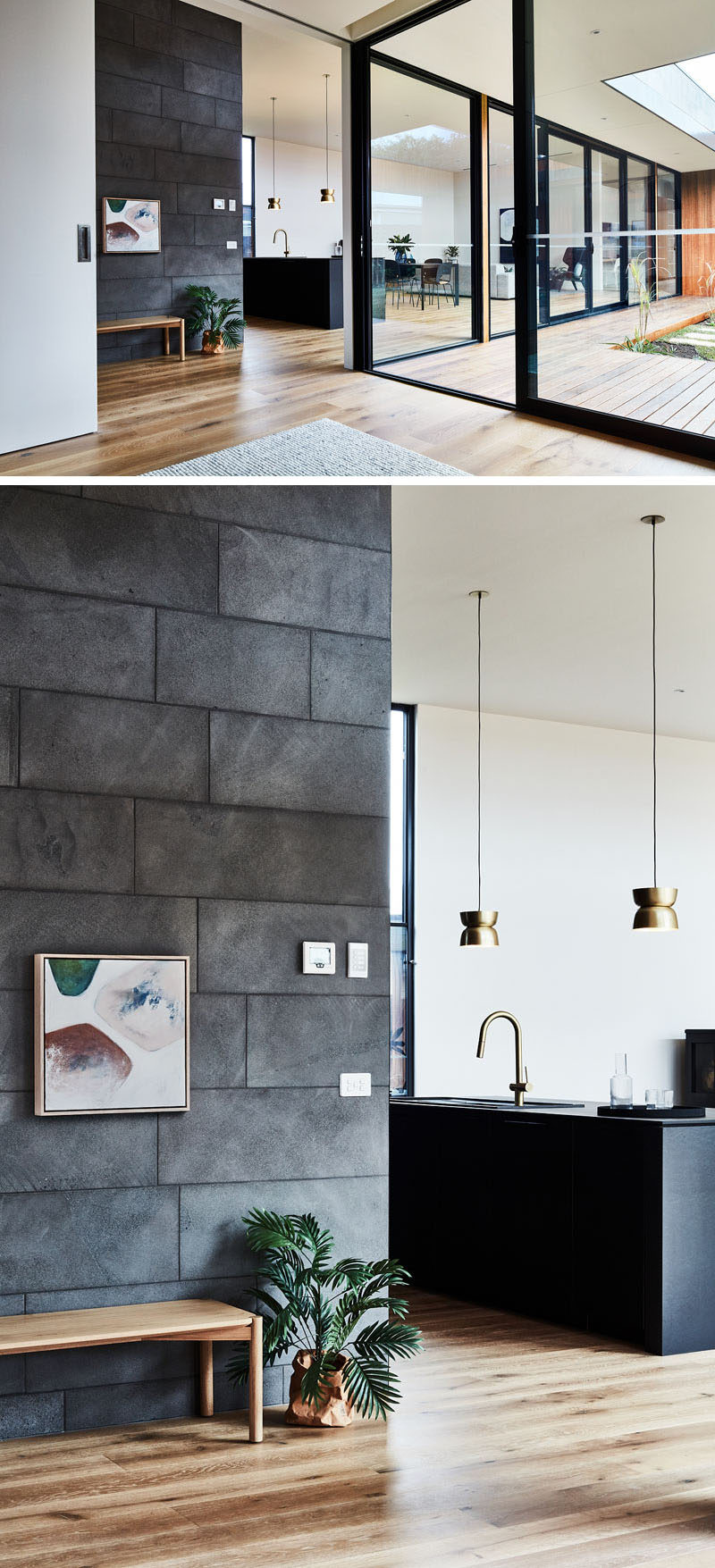 Stepping into this modern house, you become aware that the house wraps around an internal courtyard, while oak flooring adds a warm touch to the stone and black elements. #ModernHouse #InteriorDesign